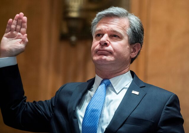 FBI Director Christopher Wray, is sworn into the Senate Homeland Security and Governmental Affairs Committee during a hearing on Threats to the Homeland, on Capitol Hill in Washington, U.S., September 24, 2020.