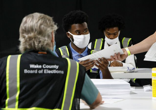Poll workers prepare absentee ballots for shipment at the Wake County Board of Elections on the first day that the state started mailing them out, in Raleigh, North Carolina, U.S. September 4, 2020.