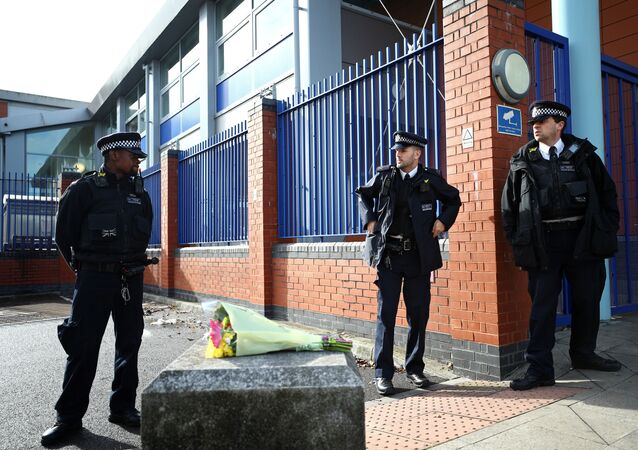 Flowers are laid down outside the custody centre where a British police officer has been shot dead in Croydon, south London.