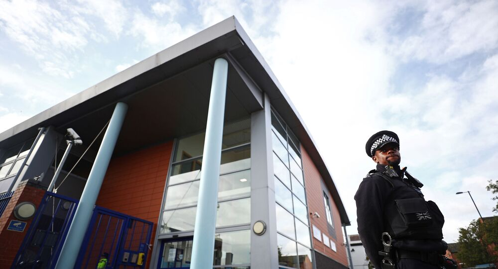A policeman stands guard outside the custody centre where a British police officer has been shot dead in Croydon, south London.