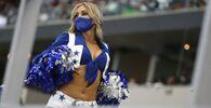 A Dallas Cowboys Cheerleader performs as the Dallas Cowboys play the Atlanta Falcons in the first half of an NFL football game in Arlington, Texas, Sunday, Sept. 20, 2020.