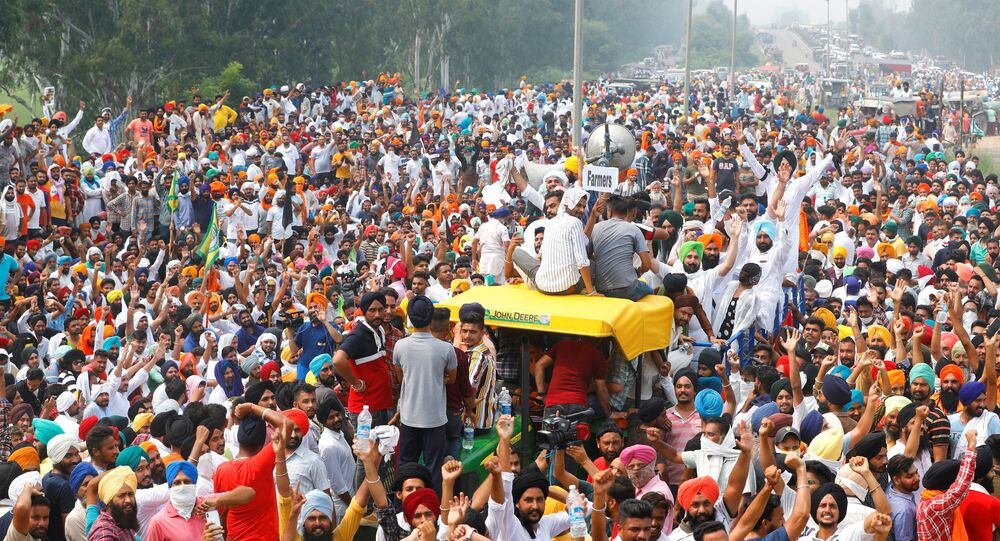 Farmers gesture as they block a national highway during a protest against farm bills passed by India's parliament, in Shambhu in the northern state of Punjab, India, September 25, 2020