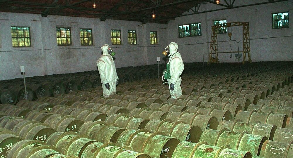 FILE - In this Saturday, May 20, 2000 file photo, two Russian soldiers make a routine check of metal containers with toxic agents at a chemical weapons storage site in the town of Gorny, 124 miles (200 kms) south of the Volga River city of Saratov, Russia