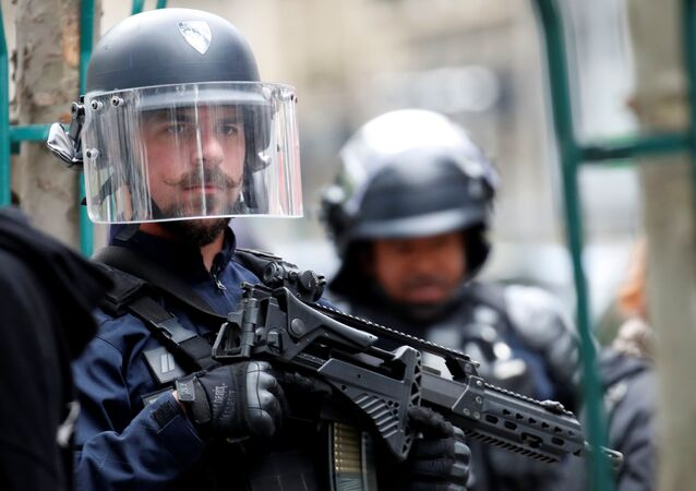 A police officer is seen at the scene of an incident near the former offices of French magazine Charlie Hebdo, in Paris, France, 25 September 2020