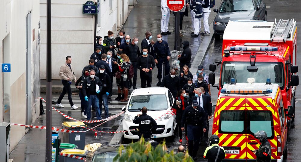 General view as police officers investigate the scene of an incident near the former offices of French magazine Charlie Hebdo, in Paris, France, 25 September 2020