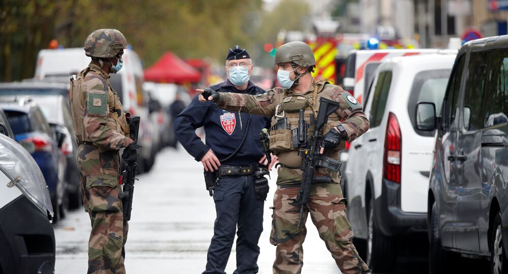 Security forces guard the scene of an incident near the former offices of French magazine Charlie Hebdo, in Paris, France September 25, 2020