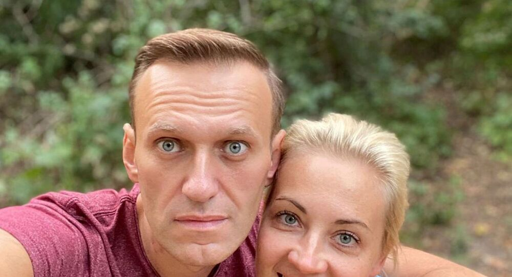 Russian opposition politician Alexei Navalny and his wife Yulia Navalnaya pose for a picture in an unknown location, in this undated image obtained from social media September 25, 2020.