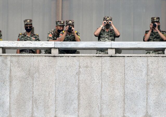 North Korean soldiers keep watch toward the south as South Korean Unification Minister Lee In-young inspects (not pictured) the truce village of Panmunjom inside the demilitarised zone separating the two Koreas, South Korea, 16 September 2020.