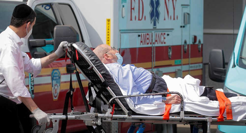 A patient arrives outside Maimonides Medical Center, as the spread of the coronavirus disease (COVID-19) continues, in the Borough Park area of Brooklyn, New York, U.S., September 25, 2020.