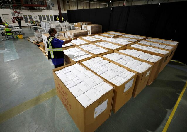 An election worker surveys thousands of absentee ballots awaiting preparation at the Wake County Board of Elections on the first day that the state started mailing out absentee ballots, in Raleigh, North Carolina, U.S. September 4, 2020.