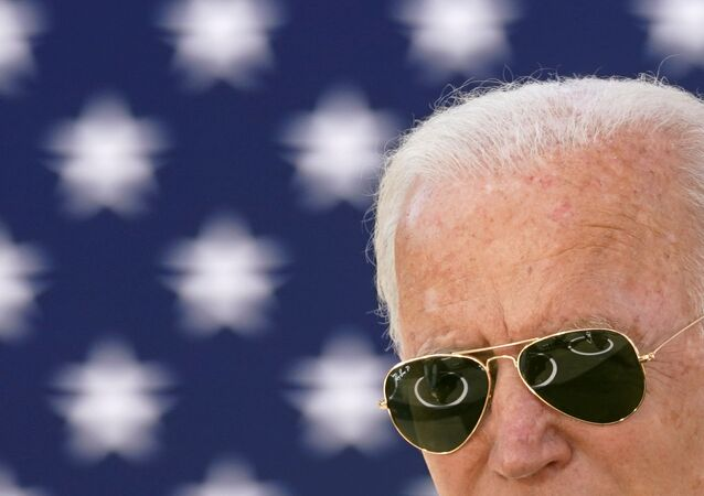 Attendees sitting in social distancing circles because of the coronavirus disease (COVID-19) pandemic are seen reflected in the sunglasses of U.S. Democratic presidential candidate Joe Biden as he speaks at an outdoor  Black Economic Summit while campaigning in Charlotte, North Carolina, U.S., September 23, 2020