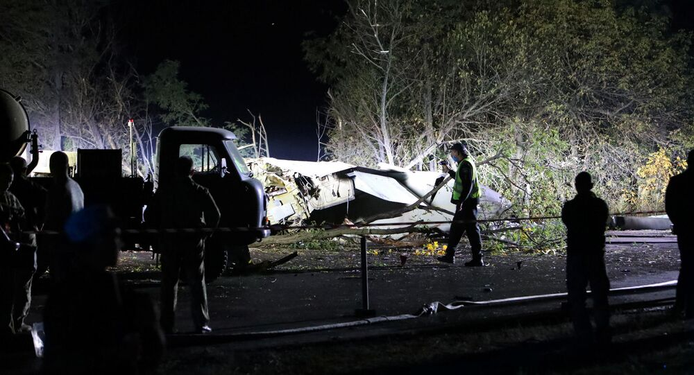 Rescuers inspect the wreckage of the Ukrainian military Antonov An-26 plane after it crashed outside of Chuhuiv town, Ukraine, 25 September 2020.