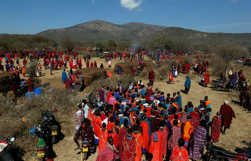 Maasai women sing for their men of Matapato clan before attending the Olng'esherr (meat-eating) passage ceremony to unite two age-sets; the older Ilpaamu and the younger Ilaitete into senior elder-hood as the final rite of passage, after the event was initially postponed due to the coronavirus disease (COVID-19) outbreak in Maparasha hills of Kajiado, Kenya 23 September 2020.