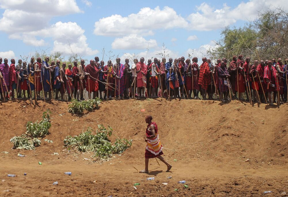 Maasai morans, or warriors, take part in an Olng'esherr ceremony at the foot of the Maparasha Hills, near Kajiado, in Kenya Wednesday 23 September 2020. The Olng'esherr ceremony, which attracted more than ten thousand Maasai from around the region, is a meat-eating rite of passage which takes place only once every 15 years and marks the end of being a young warrior and the beginning of becoming an elder.