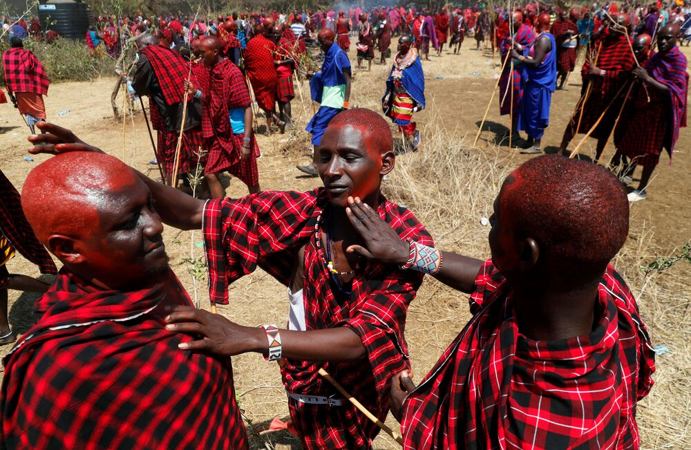 Maasai men of Matapato clan apply red orchre before attending the Olng'esherr (meat-eating) passage ceremony to unite two age-sets; the older Ilpaamu and the younger Ilaitete into senior elder-hood as the final rite of passage, after the event was initially postponed due to the coronavirus disease (COVID-19) outbreak in Maparasha hills of Kajiado, Kenya 23 September 2020.