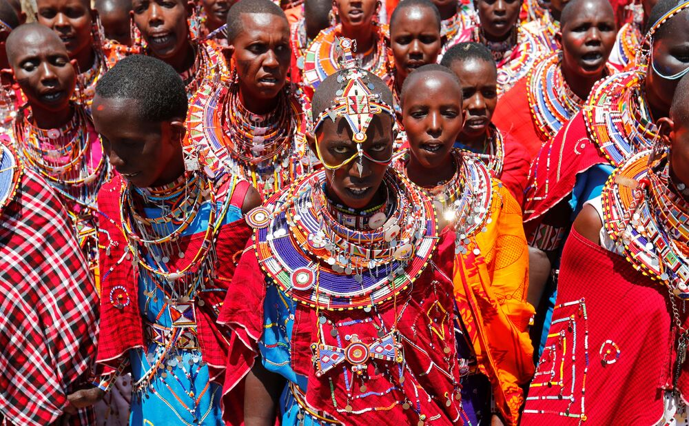 Maasai women sing for their men of Matapato clan before attending the Olng'esherr (meat-eating) passage ceremony to unite two age-sets; the older Ilpaamu and the younger Ilaitete into senior elder-hood as the final rite of passage,o after the event was initially postponed due to the coronavirus disease (COVID-19) outbreak in Maparasha hills of Kajiado, Kenya 23 September 2020.