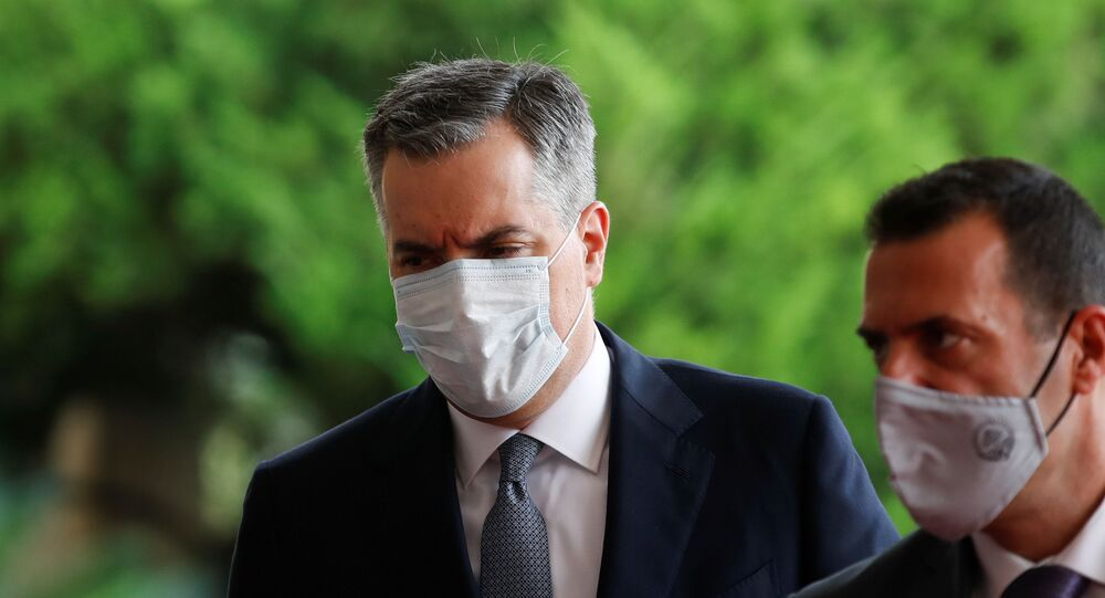 Newly appointed Lebanese Prime Minister Mustapha Adib wears a protective face mask as he arrives to attend a meeting with French President Emmanuel Macron at the presidential palace in Baabda, Lebanon September 1, 2020