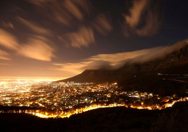 Clouds blow over Cape Town's iconic Table Mountain in Cape Town, South Africa, March 17, 2019