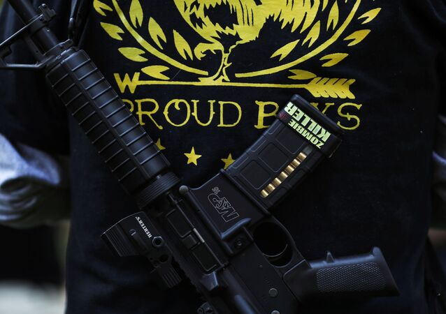 A Proud Boy carries a gun during a gathering at a local park to remember Patriot Prayer supporter Aaron J. Danielson, who was shot dead in Portland, Oregon after street clashes between supporters of President Donald Trump and counter-demonstrators, in Vancouver, Washington, U.S. September 5, 2020.