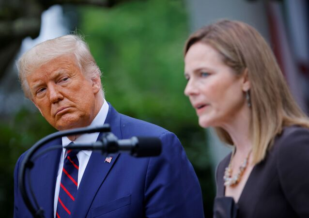 U.S President Donald Trump watches U.S. Court of Appeals for the Seventh Circuit Judge Amy Coney Barrett deliver remarks as he holds an event to announce her as his nominee to fill the Supreme Court seat left vacant by the death of Justice Ruth Bader Ginsburg, who died on September 18, at the White House in Washington, U.S., September 26, 2020