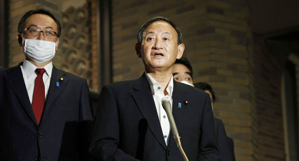 Japanese Prime Minister Yoshihide Suga meets the press at the prime minister's official residence after speaking on the phone with U.S. President Donald Trump at their first conversation since Suga took office, in Tokyo, Japan, in this photo taken by Kyodo September 20, 2020.