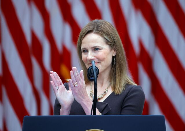 U.S. Court of Appeals for the Seventh Circuit Judge Amy Coney Barrett applauds as President Donald Trump holds an event at the White House in Washington DC, to announce her nomination to fill the Supreme Court seat left vacant on 18 September by the death of Justice Ruth Bader Ginsburg, 26 September 2020.