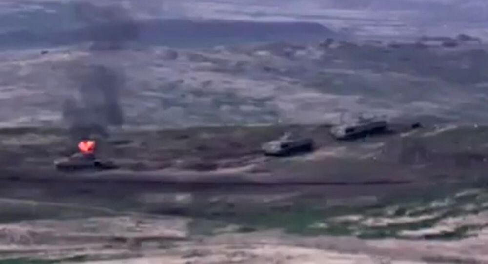 In this handout video grab released by the Armenian Defense Ministry, Armenian forces destroy Azerbaijani military vehicle at the contact line in Nagorno-Karabakh.