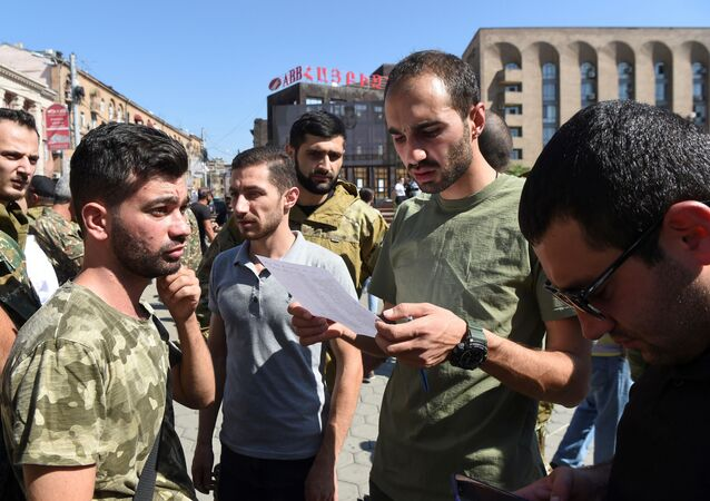 People attend a meeting to recruit military volunteers after Armenian authorities declared martial law and mobilised its male population following clashes with Azerbaijan over the breakaway Nagorno-Karabakh region in Yerevan, Armenia 27 September 2020.