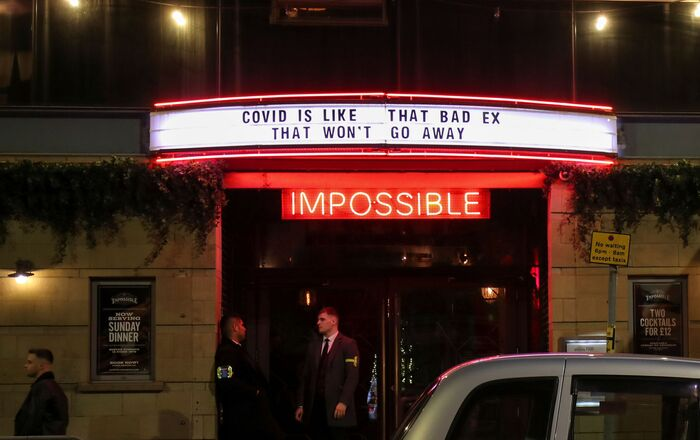 A sign is seen above the entrance of a bar, amid the coronavirus disease (COVID-19) outbreak, in Manchester, Britain September 24, 2020.