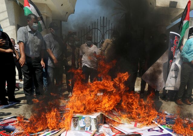 Palestinians burn pictures depicting Abu Dhabi Crown Prince Mohammed bin Zayed al-Nahyan, Israeli Prime Minister Benjamin Netanyahu and U.S. President Donald Trump during a protest against the United Arab Emirates and Bahrain's deal with Israel to normalise relations, in Gaza City September 15, 2020.
