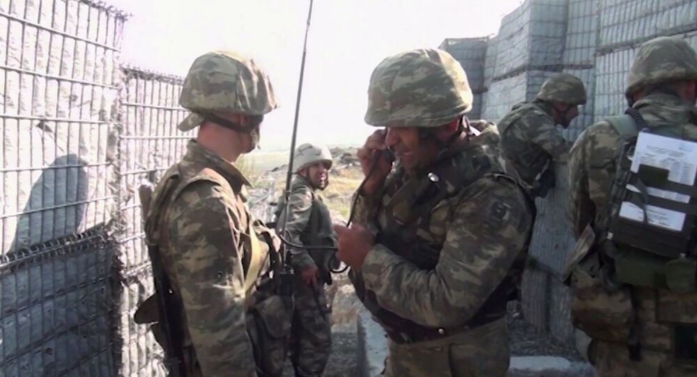 In this handout video grab released by the Azerbaijan Defence Ministry, Azeri military personnel conduct military operations in self-proclaimed Republic of Artsakh, Nagorno-Karabakh, Azerbaijan. On September 27 clashes erupted between Armenian and Azeri forces along the line of contact in the disputed region of Nagorno-Karabakh