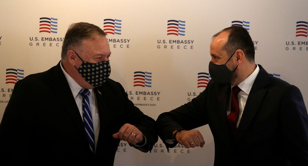 U.S. Secretary of State Mike Pompeo and North Macedonia's Deputy Prime Minister for Economy Fatmir Bytyqi touch elbows before a meeting with the Federation of Northern Greek Industries in Thessaloniki, Greece, September 28, 2020