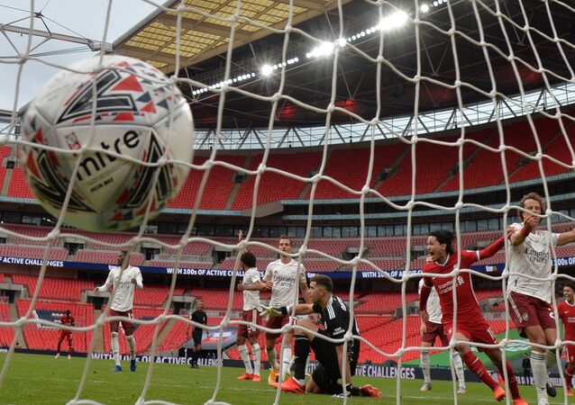 Soccer Football - FA Community Shield - Arsenal v Liverpool - Wembley Stadium, London, Britain - August 29, 2020  Liverpool's Takumi Minamino celebrates scoring their first goal, as play resumes behind closed doors following the outbreak of the coronavirus disease (COVID-19)