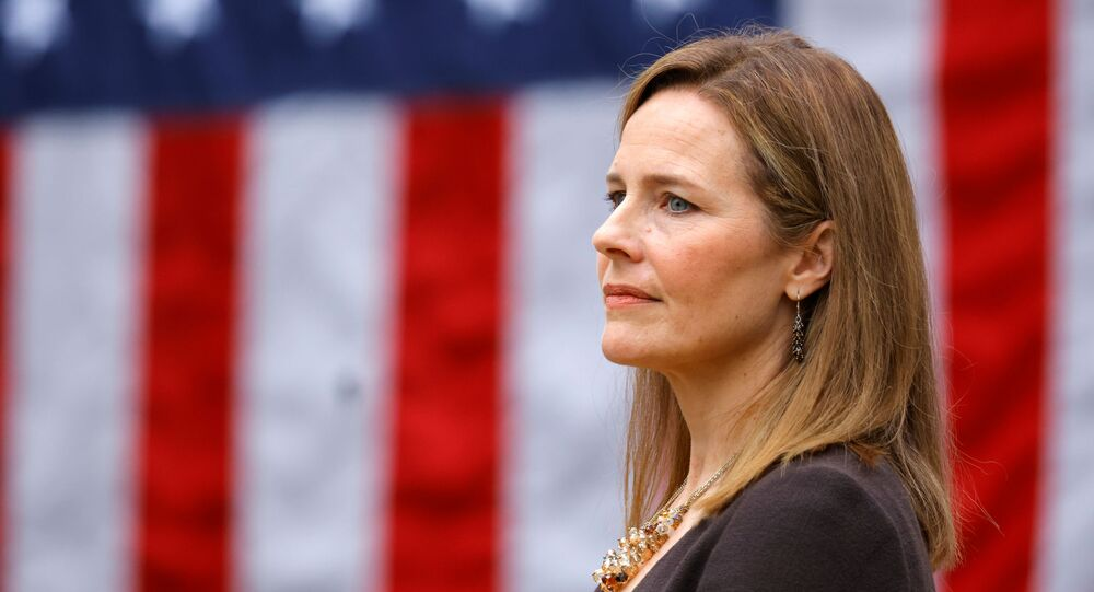 U.S. Court of Appeals for the Seventh Circuit Judge Amy Coney Barrett reacts as U.S President Donald Trump holds an event to announce her as his nominee to fill the Supreme Court seat left vacant by the death of Justice Ruth Bader Ginsburg, who died on September 18, at the White House in Washington, U.S., September 26, 2020