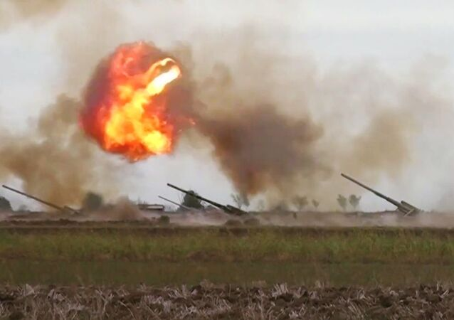 Azerbaijani forces carry out a strike against Armenian military during the conflict in Nagorno-Karabakh