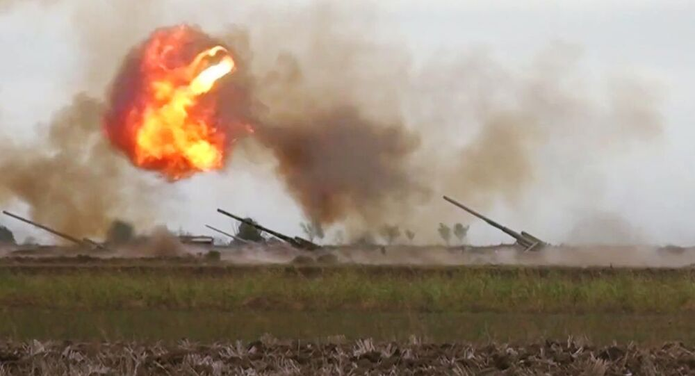 Azerbaijani forces carry out a strike against the Armenian military during the conflict in Nagorno-Karabakh