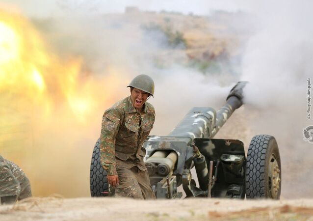 An ethnic Armenian soldier fires an artillery piece during fighting with Azerbaijan's forces in the breakaway region of Nagorno-Karabakh, in this handout picture released September 29, 2020