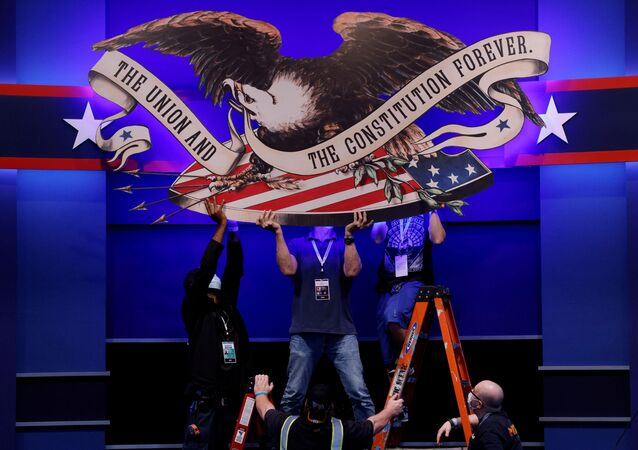 Crews prepare the hall for the first presidential debate between U.S. President Donald Trump and Democratic presidential nominee and former Vice President Joe Biden in Cleveland, Ohio, U.S., September 28, 2020
