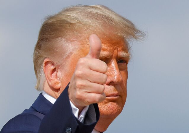 U.S. President Donald Trump gestures while boarding Air Force One as he departs Washington on campaign travel to participate in the first presidential debate with Democratic presidential nominee Joe Biden in Cleveland, Ohio at Joint Base Andrews, Maryland, U.S., September 29, 2020.