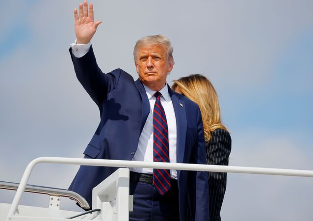 U.S. President Donald Trump and first lady Melania Trump board Air Force One as they depart Washington on campaign travel to participate in his first presidential debate with Democratic presidential nominee Joe Biden in Cleveland, Ohio at Joint Base Andrews, Maryland, U.S., September 29, 2020.