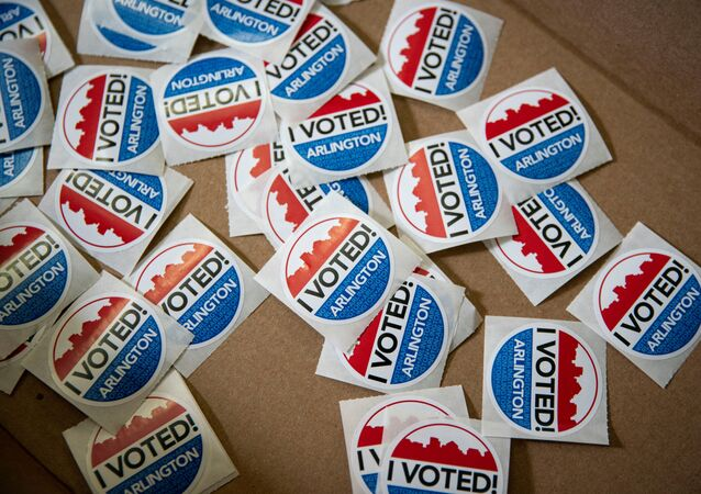 I Voted stickers lie in a box for voters after they place their ballots at an early voting site in Arlington, Virginia, U.S., September 18, 2020.