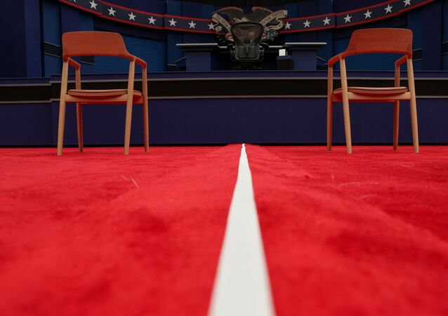 A white line divides the two halves of the audience as the stage awaits U.S. President Donald Trump and Democratic U.S. presidential nominee and former Vice President Joe Biden before their first presidential debate on the campus of the Cleveland Clinic in Cleveland, Ohio, U.S. September 29, 2020.