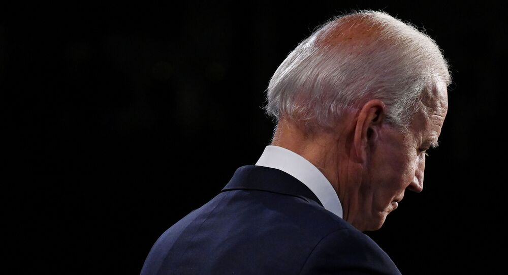 Democratic presidential nominee Joe Biden listens as he participates in the first 2020 presidential campaign debate with U.S. President Donald Trump held on the campus of the Cleveland Clinic at Case Western Reserve University in Cleveland, Ohio, U.S., September 29, 2020.