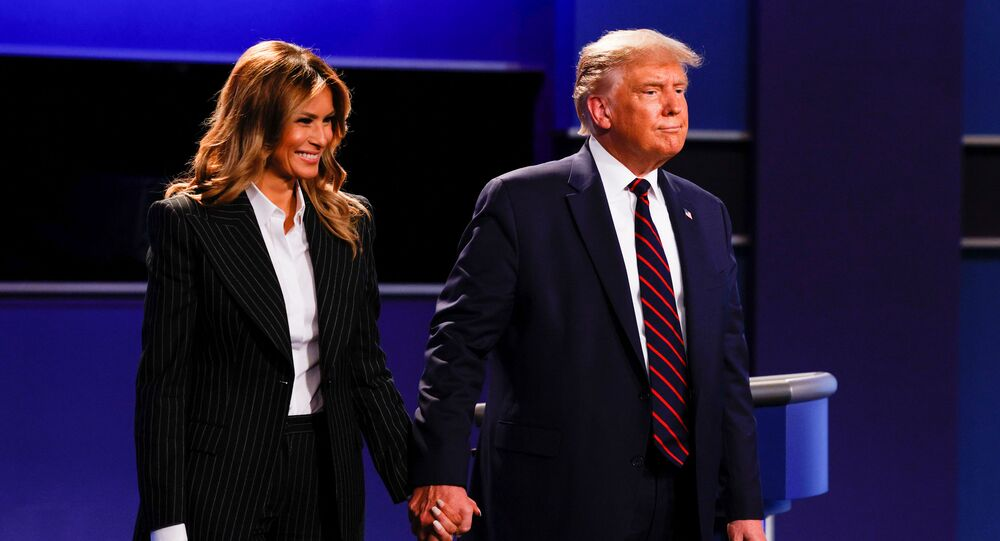 US President Donald Trump and first lady Melania Trump leave the stage after the first 2020 presidential campaign debate with Democrat presidential nominee Joe Biden, on the campus of the Cleveland Clinic at Case Western Reserve University in Cleveland, Ohio, US, 29 September 2020.