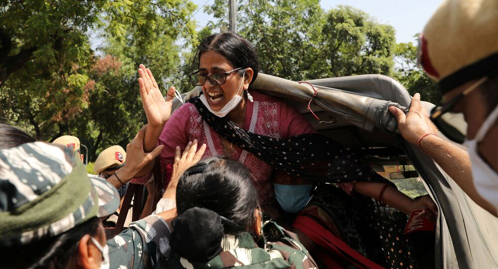 A demonstrator is detained by police during a protest after the death of a rape victim, in front of Uttar Pradesh state bhawan (building) in New Delhi, India, September 30, 2020