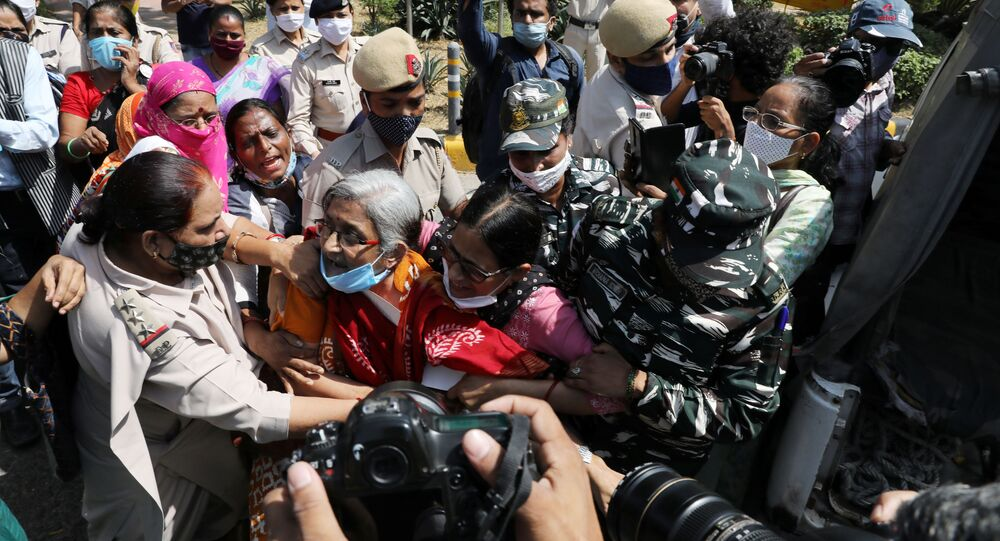 Demonstrators are detained by police during a protest after the death of a rape victim, in front of Uttar Pradesh state bhawan (building) in New Delhi, India, September 30, 2020