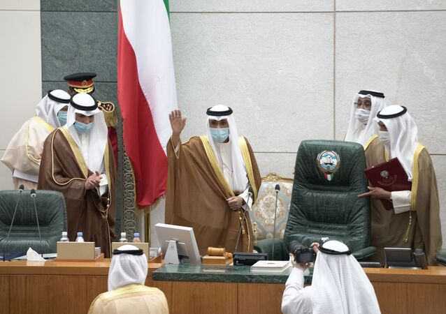 Kuwait's new Emir Nawwaf al-Ahmad al-Sabah gestures as he takes the oath of office at the parliament, in Kuwait City, Kuwait September 30, 2020