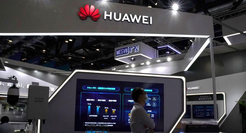 A man wearing a face mask following the coronavirus disease (COVID-19) outbreak walks past a booth of Huawei at the 2020 China International Fair for Trade in Services (CIFTIS) in Beijing, China September 4, 2020