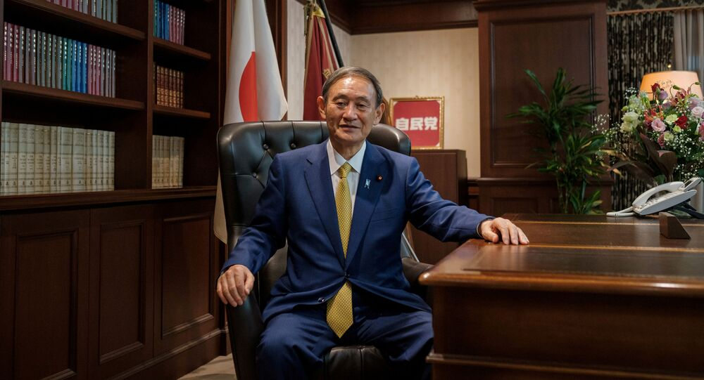 Japanese Chief Cabinet Secretary Yoshihide Suga poses for a picture following his press conference at LDP (Liberal Democratic Party) headquarters, in Tokyo, Japan September 14, 2020