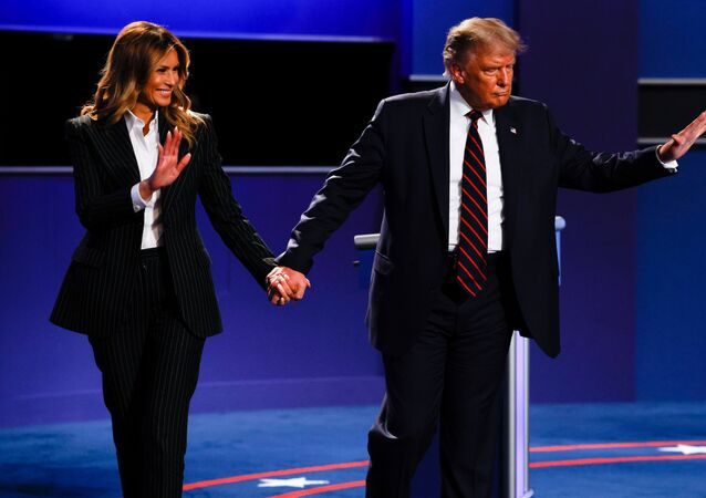 President Donald Trump and first lady Melania Trump wave as they leave the stage at the conclusion of  U.S. President Donald Trump and Democratic presidential nominee Joe Biden participate first 2020 presidential campaign debate held on the campus of the Cleveland Clinic at Case Western Reserve University in Cleveland, Ohio, U.S., September 29, 2020